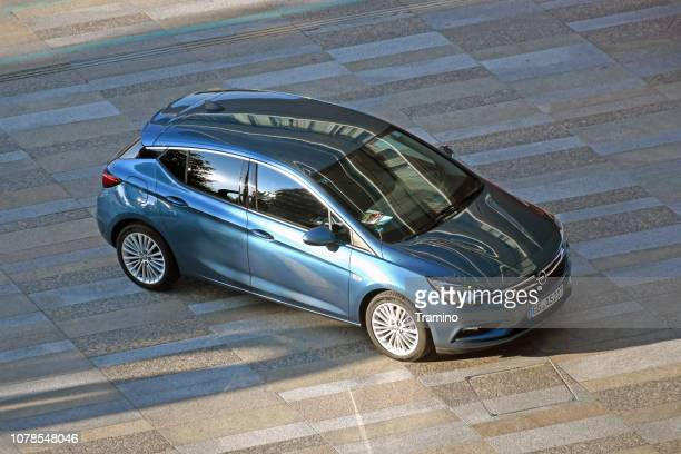 opel astra v on the street - psa stock photos and pictures