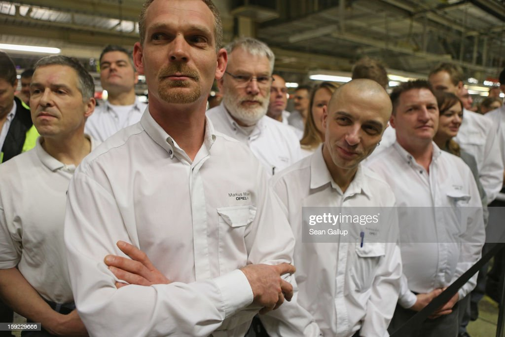 Opel car factory workers attend a celebration to mark the launch of the new Opel Adam compact car at the Opel factory on January 10, 2013 in Eisenach, Germany. Opel employees hope the car will help the compny return to profits after years of sagging sales and the announcement of the Bochum factory closure in 2016.