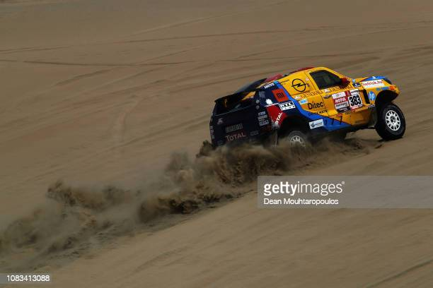 Opel Dakar Team no 383 OPEL GRANDLAND X car driven by Balazs Szalay of Hungary and Laszlo Bunkoczi of Hungary compete in the sand desert and dunes...