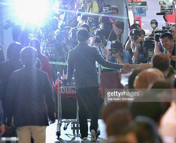 US Open 2014 runnerup Kei Nishikori shakes hands with fans upon arrival from the US Open at Narita International Airport on September 13 2014 in...