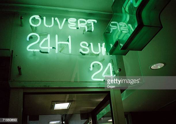 ?Open 24 hours? neon sign