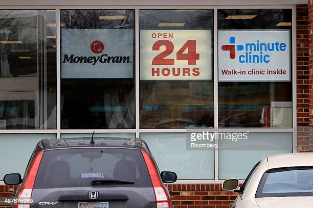 A 'Open 24 Hours' sign is displayed in the window of a CVS Caremark Corp store in Dallas Texas US on Friday Feb 7 2014 CVS Caremark Corp is scheduled...