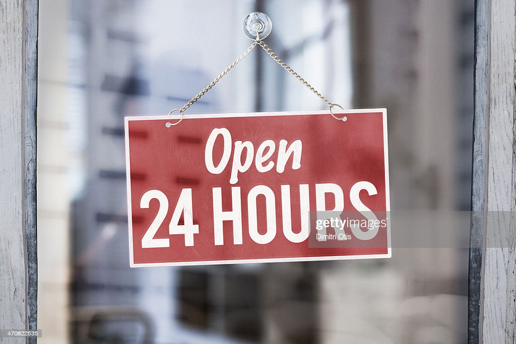 Open 24 Hours Sign On Glass Of Shop Door Stock Photo Getty Images