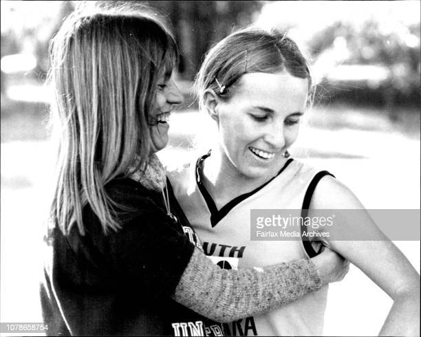 Open 5000m cross country champion and Country cross country 5000m champion of NSW Rosemary Bell being congratulated by woman marathon runner Georgina...