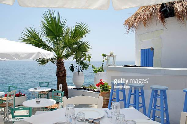open air restaurant by the sea in athens, greece - greece stock pictures, royalty-free photos & images