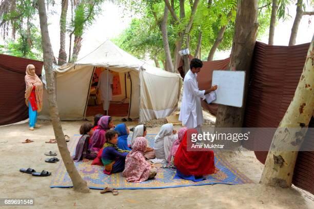 open air school after flood destruction - pakistani culture stock photos and pictures