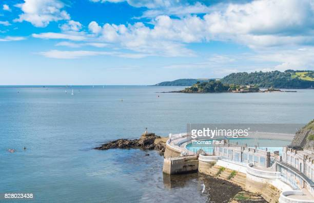 open air swimming pool on the coast of plymouth - plymouth stock photos and pictures