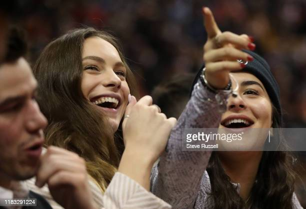 Open and Rogers Cup tennis champion Bianca Andreescu sits courtside with Olympic Swimming Champion Penny Oleksiak as the Toronto Raptors beat the...