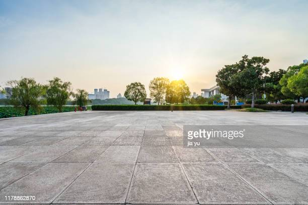 open area against sunset sky - pavement stock pictures, royalty-free photos & images