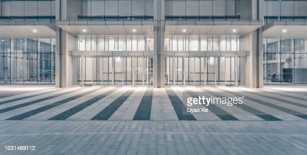 open area in front of lujiazui office building - facade stock pictures, royalty-free photos & images