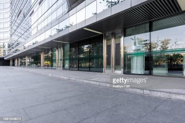 open area in front of the building - pavement stock pictures, royalty-free photos & images