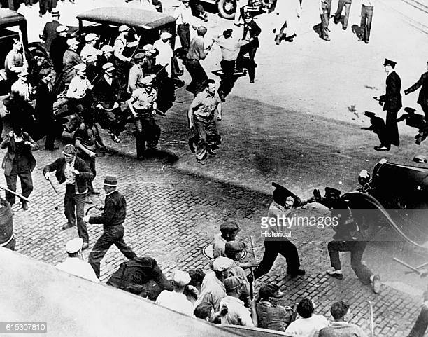 Open battle between striking teamsters armed with pipes and the police in the streets of Minneapolis June 1934