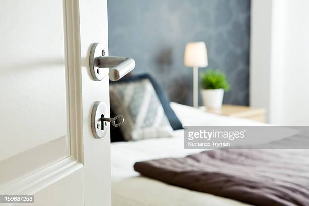 open bedroom door with key - doorway stock pictures, royalty-free photos & images