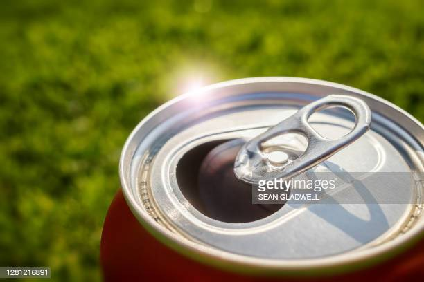 open beer can in summer - tin can stock pictures, royalty-free photos & images