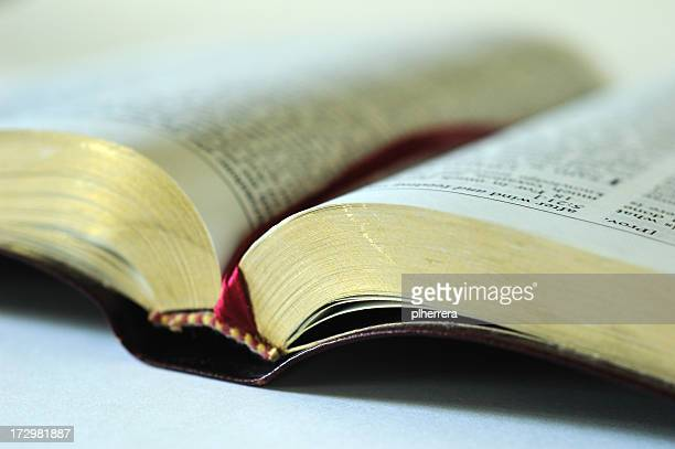 open bible with a red bookmark inside - bible stock pictures, royalty-free photos & images