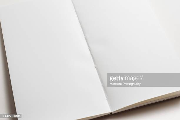 open blank magazine book for white background - blank magazine ad stock pictures, royalty-free photos & images