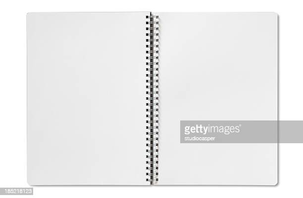 Open blank spiral notebook on a white background