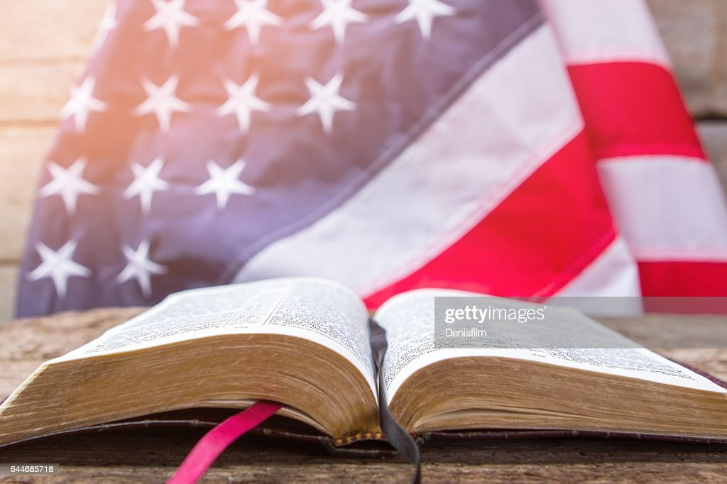 Open book and american flag. : Stock Photo