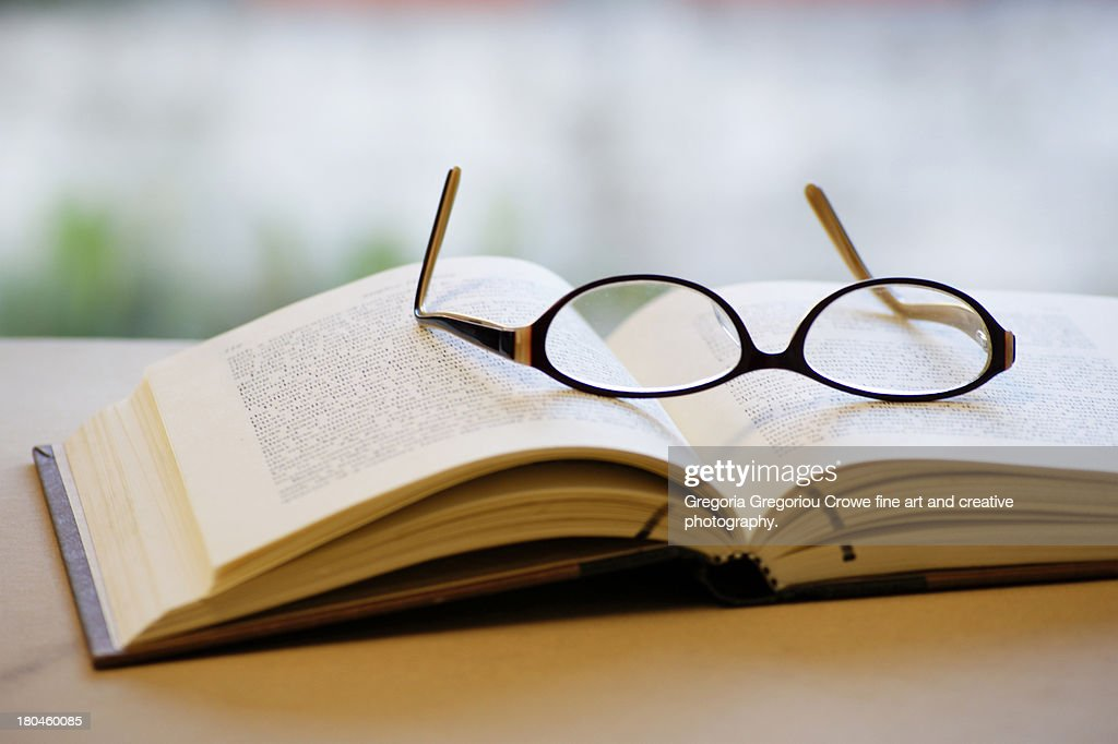 Open book and glasses : Stock Photo
