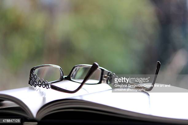 open book and glasses - gregoria gregoriou crowe fine art and creative photography. fotografías e imágenes de stock