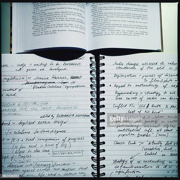 open book and notepad in detail - handwriting stock pictures, royalty-free photos & images