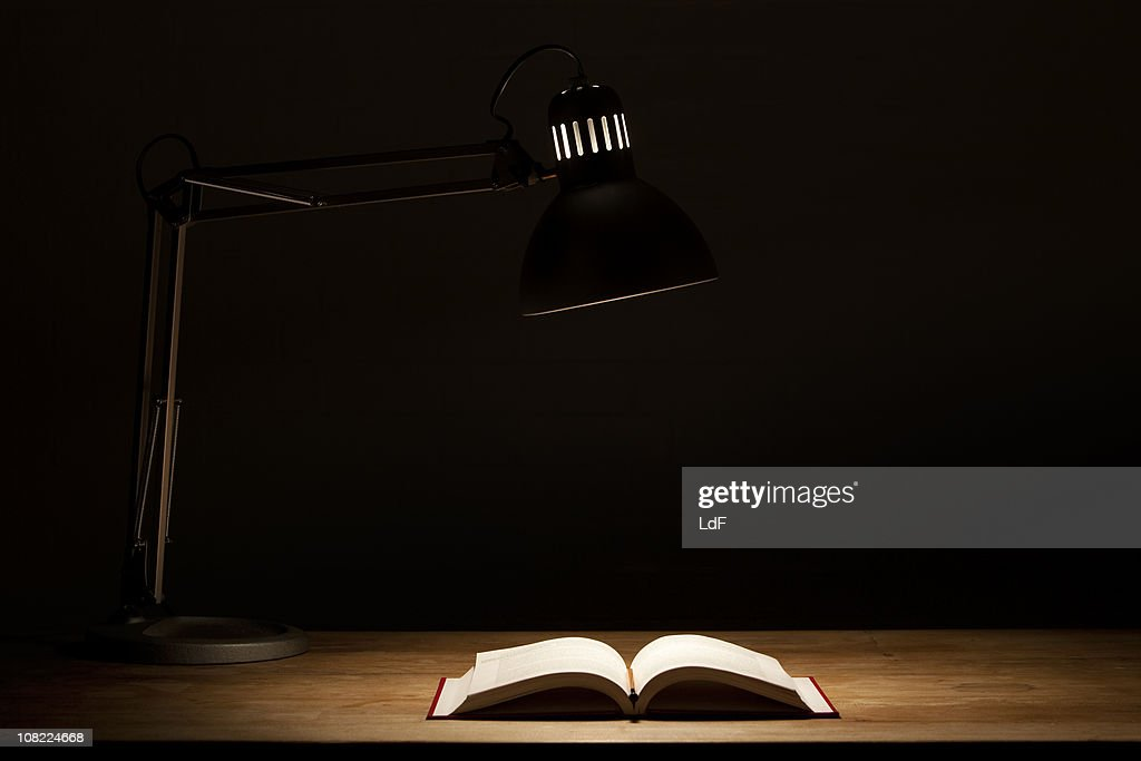 Open Book by Lamp Light : Stock Photo