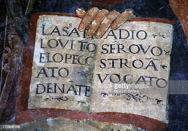 Open book in the hand of St Anthony fresco detail Church of St Lawrence Paggese Marche Italy