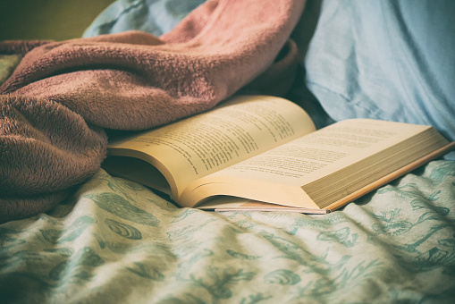 Open book on a bed - gettyimageskorea