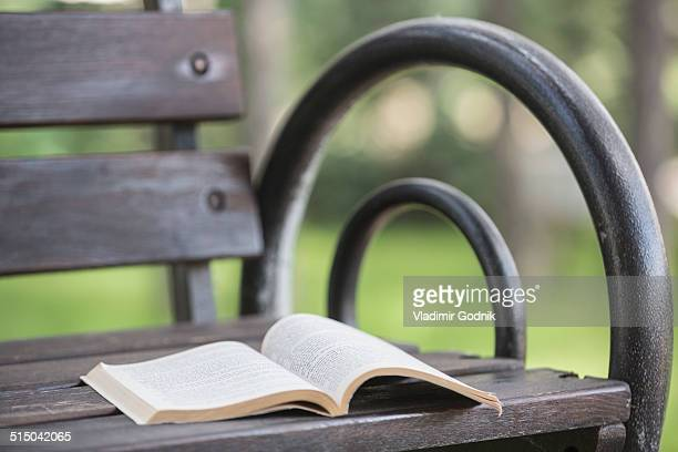 Open book on bench in park