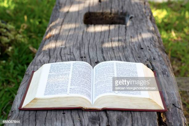 open book on wood background - old book stock pictures, royalty-free photos & images