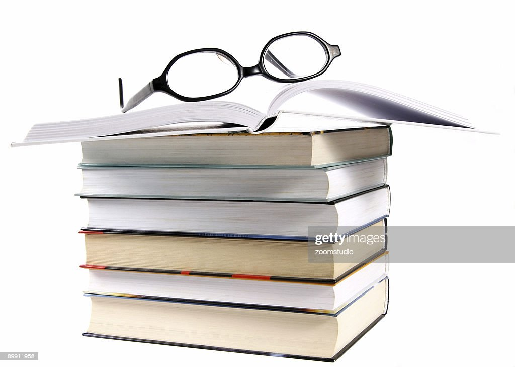 open book stack and eyeglasses stock photo getty images
