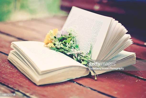 Open book with bunch of flowers