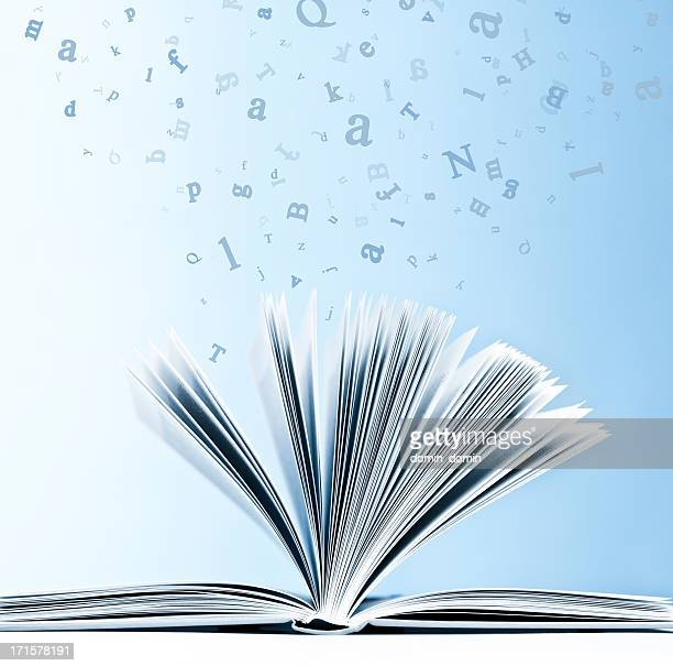 open book with flying, scattered letters isolated on blue background - dictionary stock pictures, royalty-free photos & images