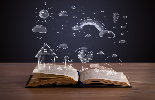 Open book with hand drawn landscape 1087508538