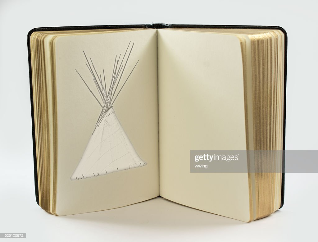 Open Book With Page Of Teepee Drawing Copy Space Stock Photo