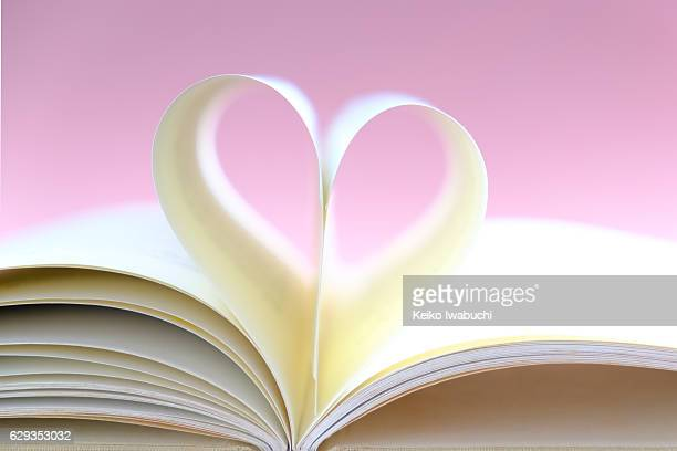 Open book with the pages in the shape of heart