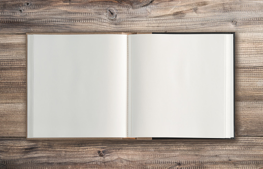 Open book wooden background Minimal flat lay 967305182