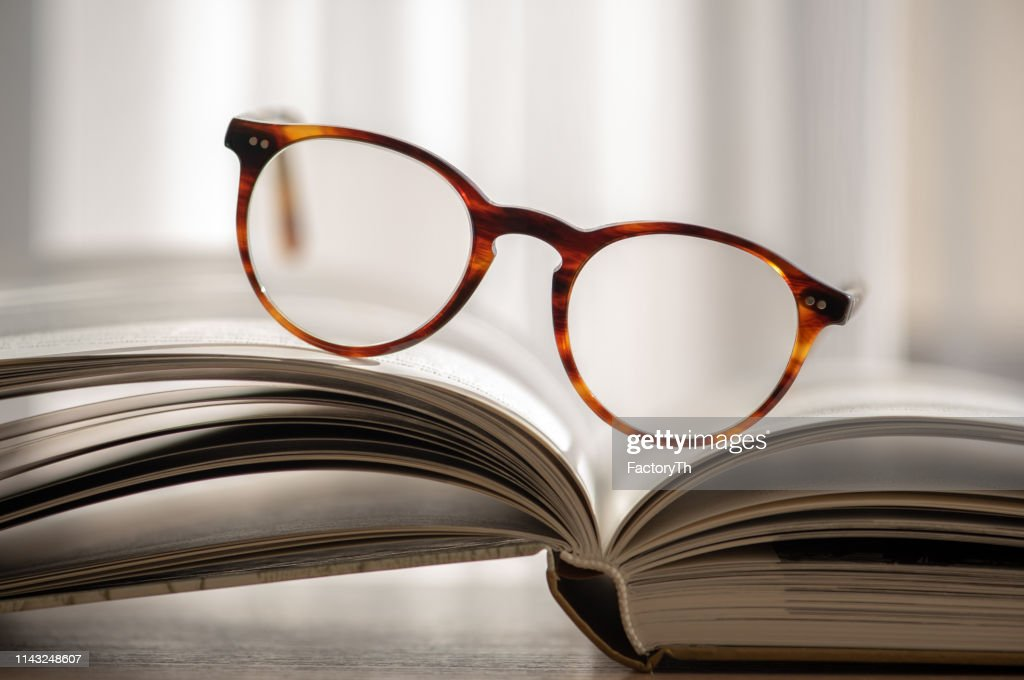 Open books and glasses : Stock Photo