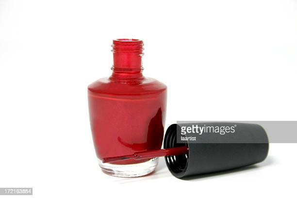 Open bottle of red nail varnish