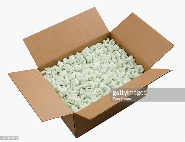 open box filled with packing peanuts - polystyrene stock pictures, royalty-free photos & images