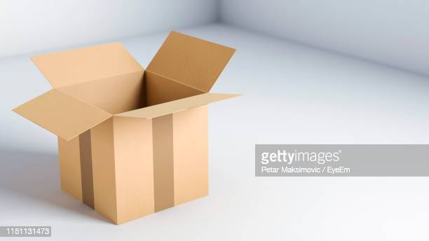 open cardboard box on white background - cardboard box stock pictures, royalty-free photos & images