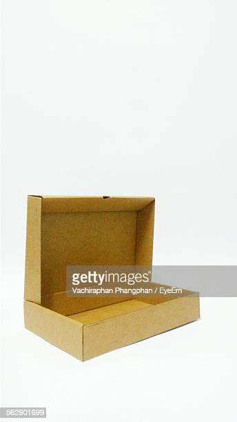 Open Cardboard Box Over White Background
