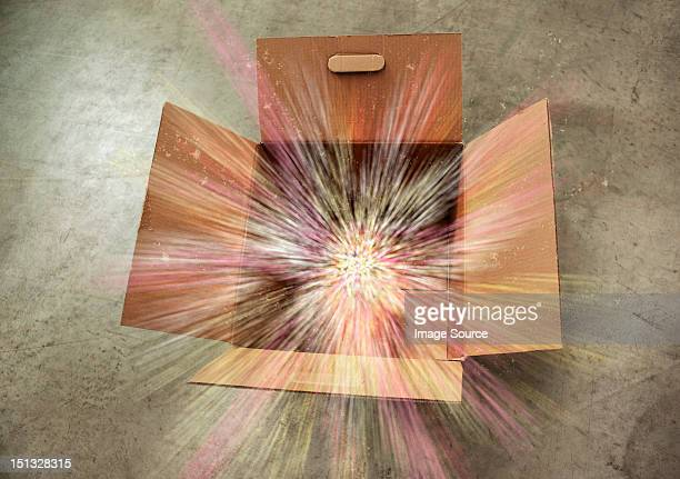 Open cardboard box with sparks