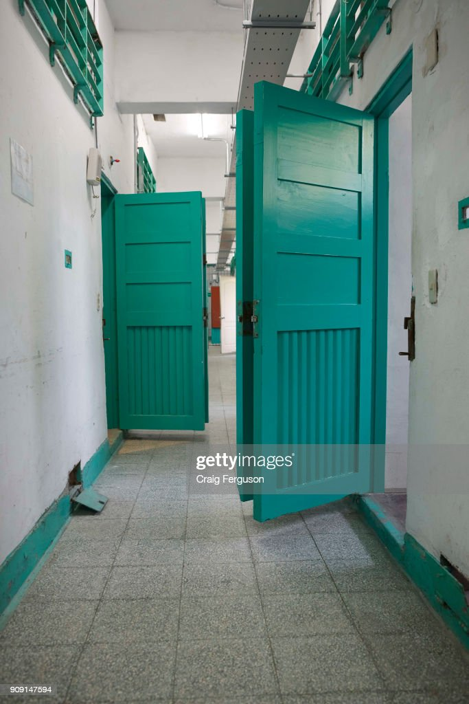 Open cell doors in a prison corridor at the Jingmei Military Detention Center. Now re & Open cell doors in a prison corridor at the Jingmei Military ...