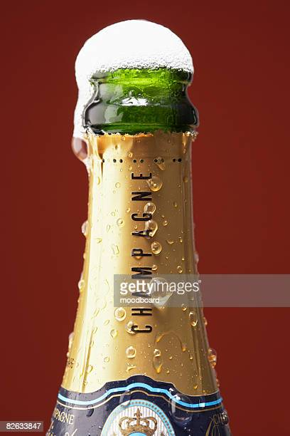 Open champagne bottle overflowing