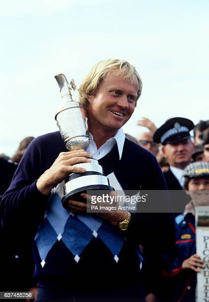 Open Champion Jack Nicklaus keeps a tight hold of the Claret Jug