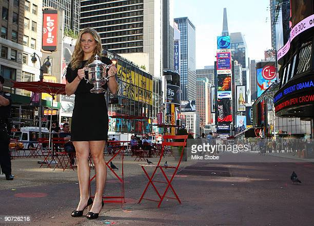 Open Champion Kim Clijsters from Belgium poses with her trophy in New York's Times Square after her victory against Caroline Wozniacki from Denmark...