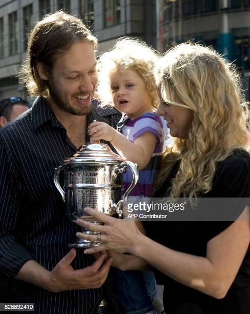 US Open Champion Kim Clijsters poses with her husband Brian Lynch and daughter Jada in Times Square after her victory against Caroline Wozniacki from...