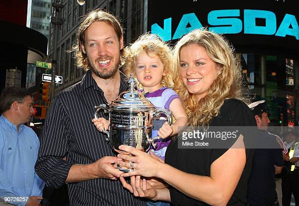 Open Champion Kim Clijsters poses with her husband Brian Lynch and daughter Jada in Times Square after her victory against Caroline Wozniacki from...