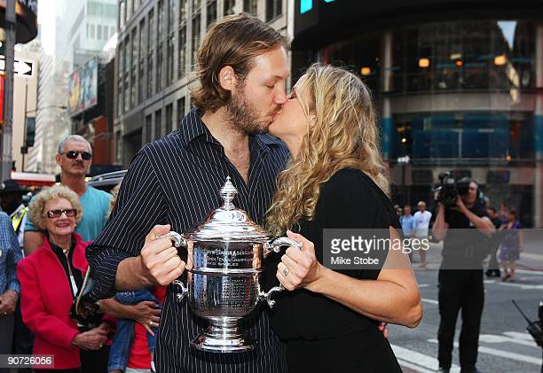 Open Champion Kim Clijsters poses with her husband Brian Lynch in Times Square after her victory against Caroline Wozniacki from Denmark during the...